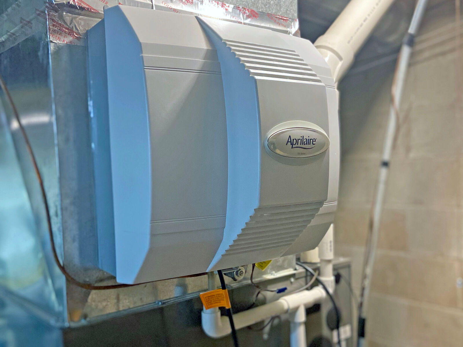 A newer hvac-mounted humidifier unit