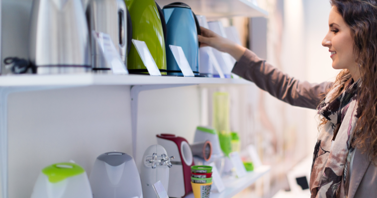 Woman shopping for electric tea kettle