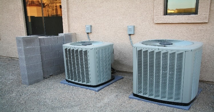 central air conditioning units next to house