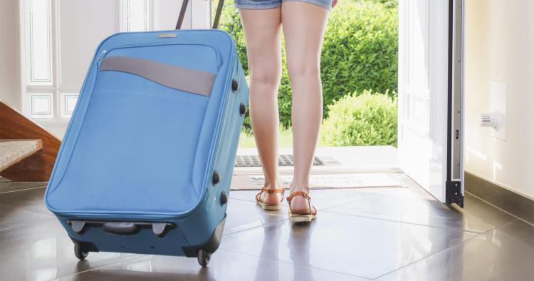 Going on vacation, women carrying suitcase