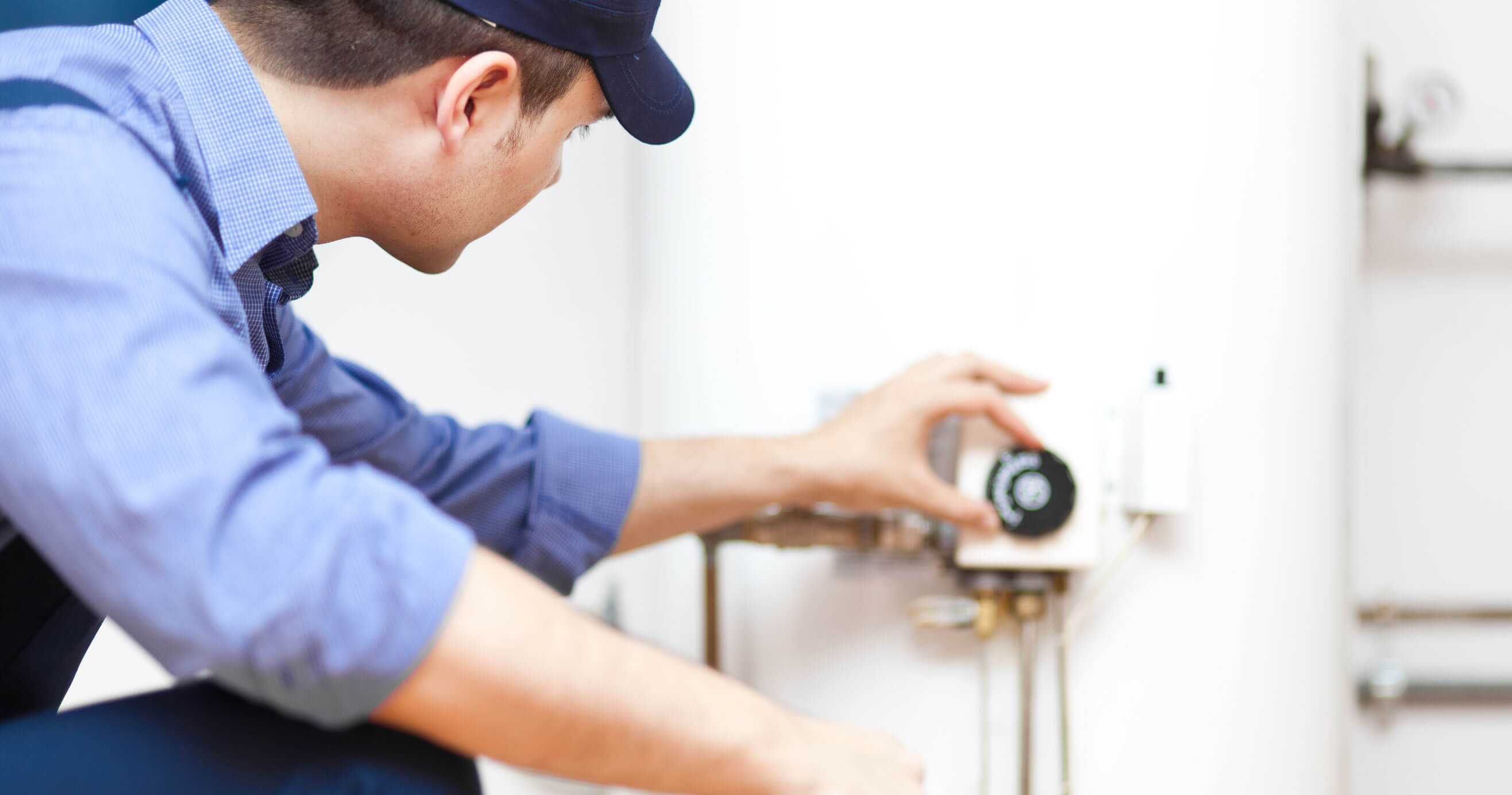 Repairman working on hot water heater.