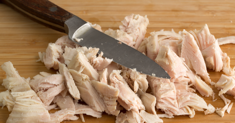 Leftover sliced turkey with knife laying on top
