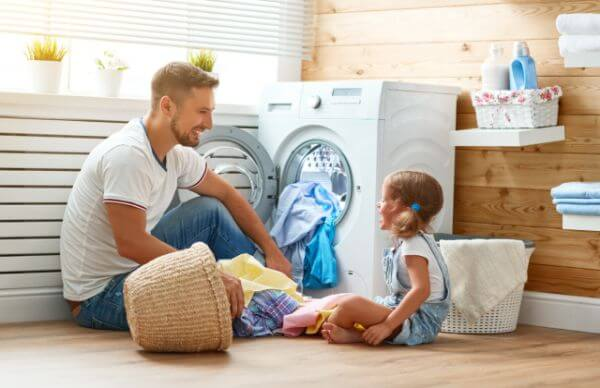 Dad and daughter doing laundry