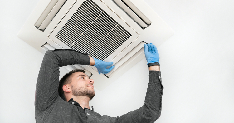 Man fixing air vent