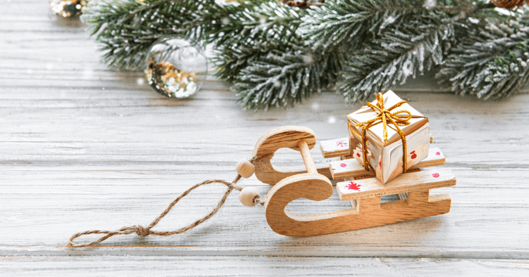 Small decorative sled carrying gift box