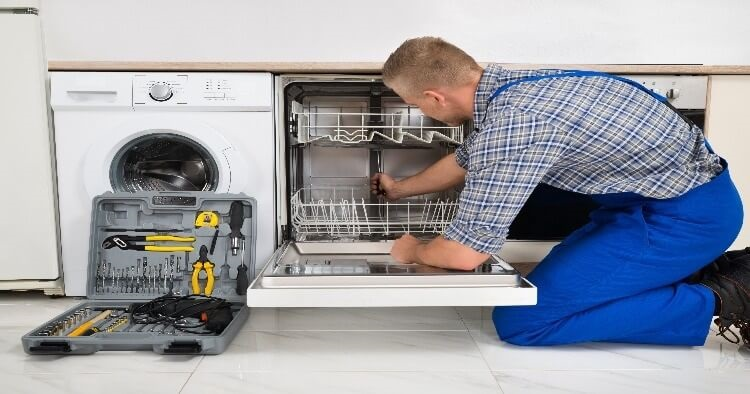 man fixing the dishwasher