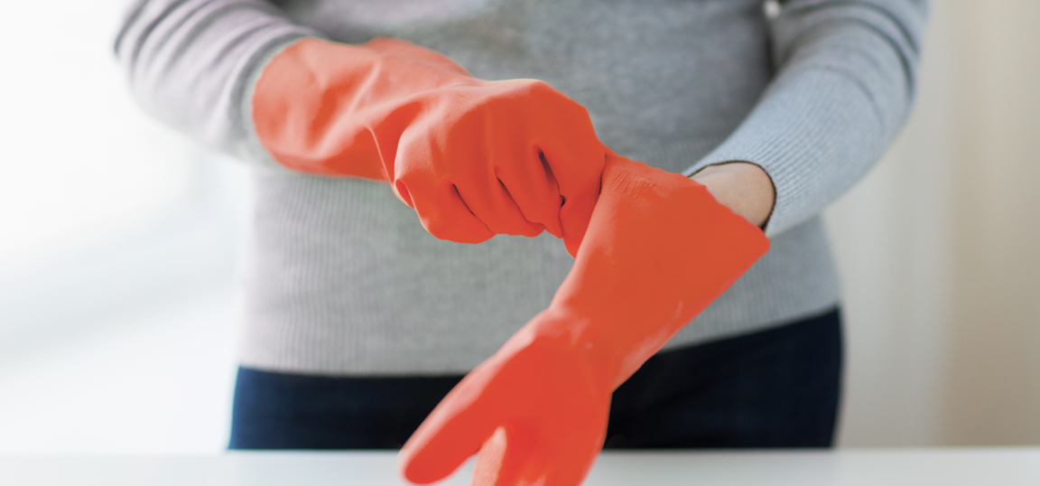 Woman wearing red rubber gloves
