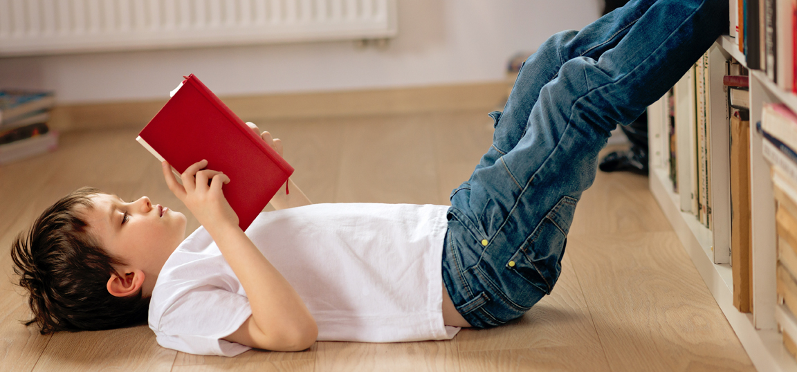 Child laying down reading
