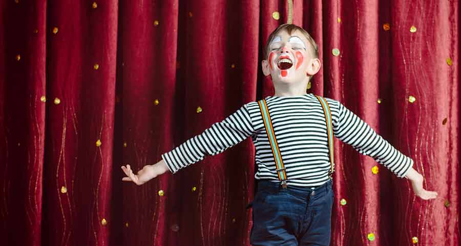 Boy dressed as a clown - play and drama
