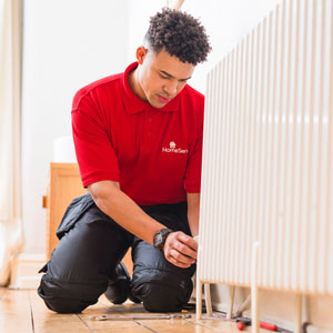HomeServe approved engineer repairing plumbing in flat