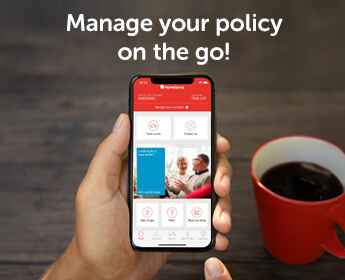 Man's hand next to mug of coffee, holding iPhone X with HomeServe App homescreen on the screen - 'Manage your policy on the go!'