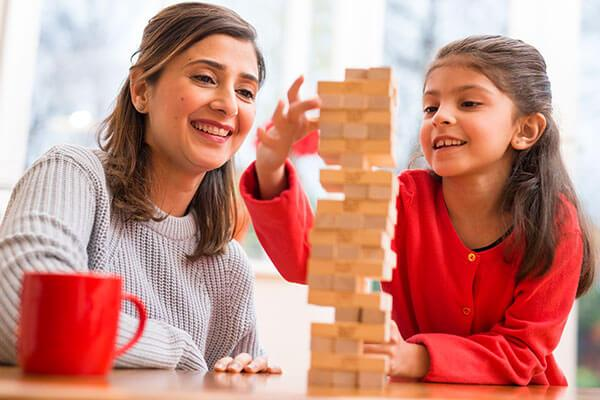 Mum playing Jenga with daughter -